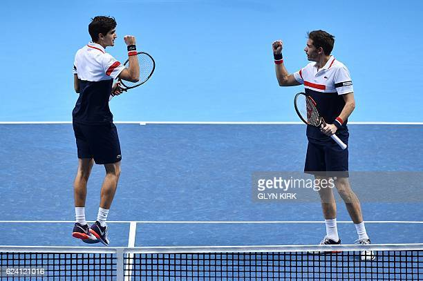 France's PierreHugues Herbert and France's Nicolas Mahut celebrate winning the first set against Australia's John Peers and Finland's Henri Kontinen...