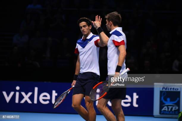 France's PierreHugues Herbert and France's Nicolas Mahut play against USA's Ryan Harrison and New Zealand's Michael Venus during their men's doubles...