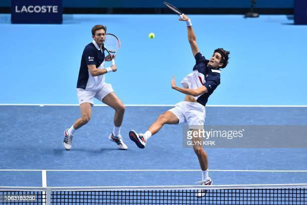 France's PierreHugues Herbert and France's Nicolas Mahut return against US player Jack Sock and US player Mike Bryan during their men's doubles final...