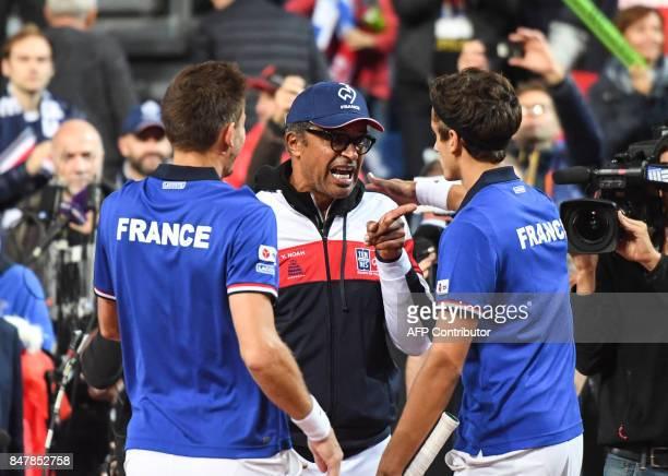 France's PierreHugues Herbert and Nicolas Mahut celebrate with France's captain Yannick Noah after winning their Davis Cup semifinal tennis match...