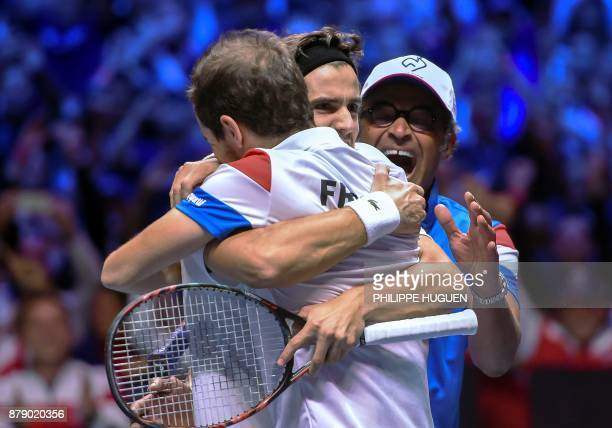 TOPSHOT France's PierreHugues Herbert and Richard Gasquet celebrate with France's captain Yannick Noah celebrate their victory after the doubles...