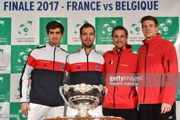 France's PierreHugues Herbert and Richard Gasquet pose with Belgium's Ruben Bemelmans and Arthur de Greef and the trophy during the team presentation...