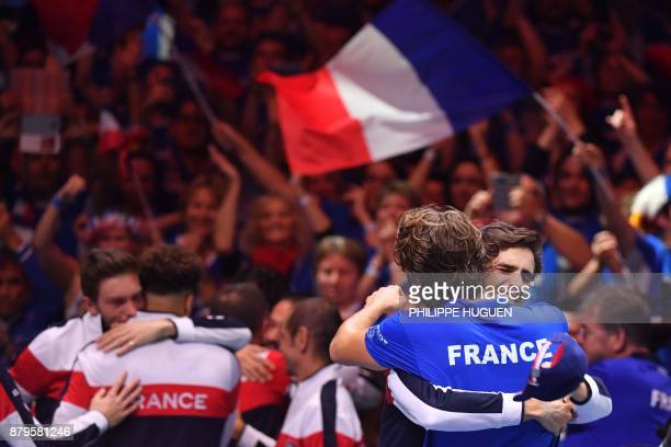 France's PierreHugues Herbert celebrates Lucas Pouille after he won his singles rubber 5 match against Belgium's Steve Darcis at the Davis Cup World...