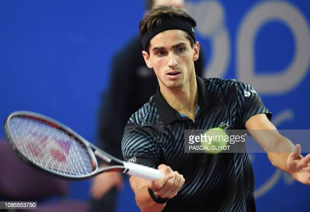 France's PierreHugues Herbert returns the ball to Canada's Denis Shapovalov during their tennis match at the Open Sud de France ATP World Tour in...