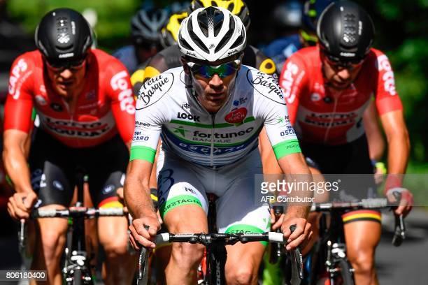 France's PierreLuc Perichon rides in a breakaway between Australia's Adam Hansen and Belgium's Thomas De Gendt during the 2125 km third stage of the...