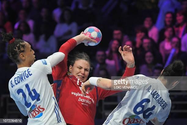 France's pivot Beatrice Edwige and France's left back Alexandra Lacrabere vie with Serbia's pivot Dragana Cvijic during the Women Euro 2018 handball...