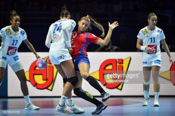 France's pivot Beatrice Edwige vies with Serbia's center back Aleksandra Vukajlovic during the Women Euro 2018 handball Championships Group 1 main...