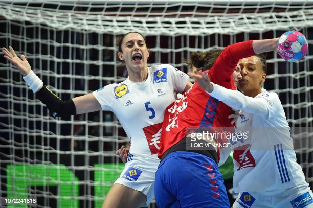 France's pivot Beatrice Edwige vies with Serbia's pivot Dragana Cvijic during the Women Euro 2018 handball Championships Group 1 main round match...