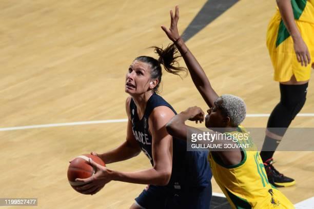 France's pivot Helena Ciak fights for the ball with Brazilian's pivot Carolina Oliveira during the FIBA Women's Olympic Qualifying Tournament match...
