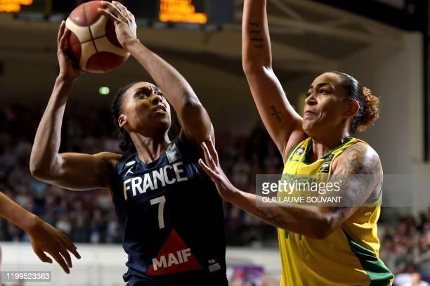 France's pivot Sandrine Gruda fights for the ball with Brazilian's pivot Erika De Souza during the FIBA Women's Olympic Qualifying Tournament match...