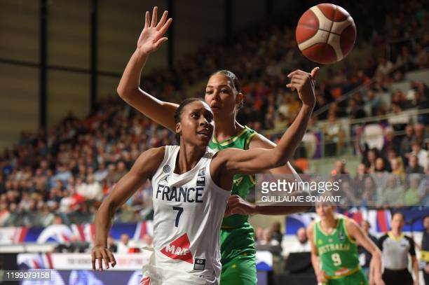 France's pivot Sandrine Gruda vies for the ball with Australian's pivot Liz Cambage during the FIBA Women's Olympic Qualifying Tournament match...