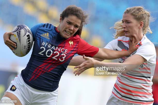 France's player Cyrielle Banet vies with England's player Olivia Jones during the women's Rugby Sevens Grand Prix Series match between France and...