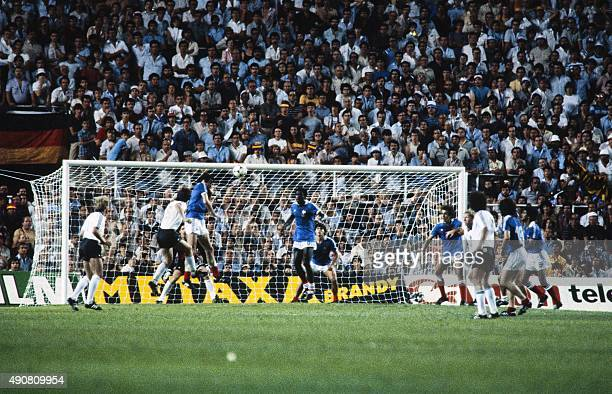 France's player heads the ball in front of french defender Marius Tresor during the 1982 World Cup semifinal football match between West Germany and...