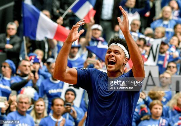 France's player JoWilfried Tsonga reacts after winning the Davis Cup World Group semifinal tennis match against Serbia at The Pierre Mauroy Stadium...