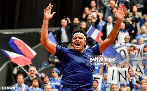 TOPSHOT France's player JoWilfried Tsonga reacts after winning the Davis Cup World Group semifinal tennis match against Serbia at The Pierre Mauroy...