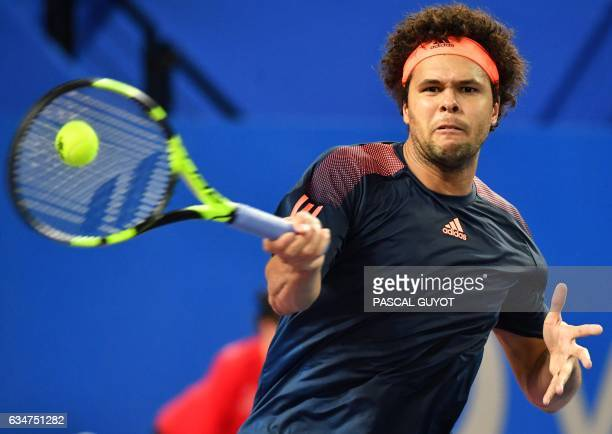 France's player JoWilfried Tsonga returns the ball to German player Alexander Zverev during their Open Sud de France ATP World Tour semifinal tennis...