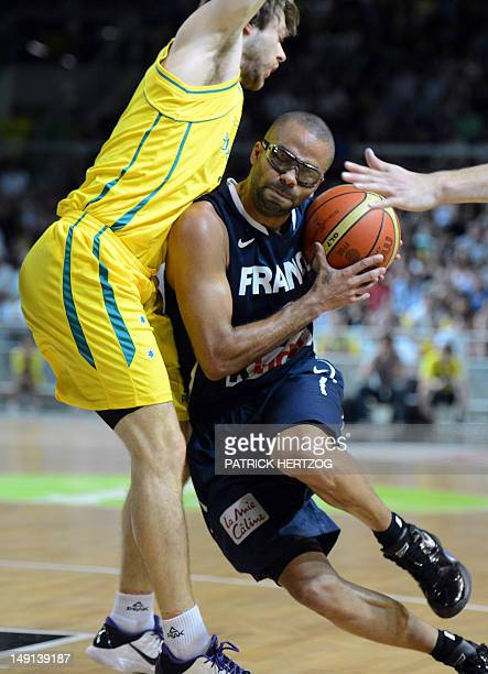 France's player Tony Parker vies with Australia's player Matthew Dellavedova, during the basketball match France vs Australia, in Strasbourg, eastern...
