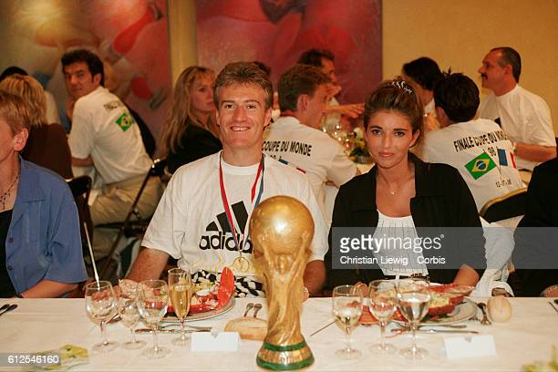 France's players are received at the French soccer federation after their 30 victory over Brazil in the final of the 1998 FIFA World Cup France's...
