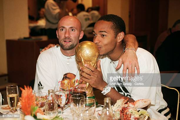 France's players are received at the French soccer federation after their 30 victory over Brazil in the final of the 1998 FIFA World Cup With the...