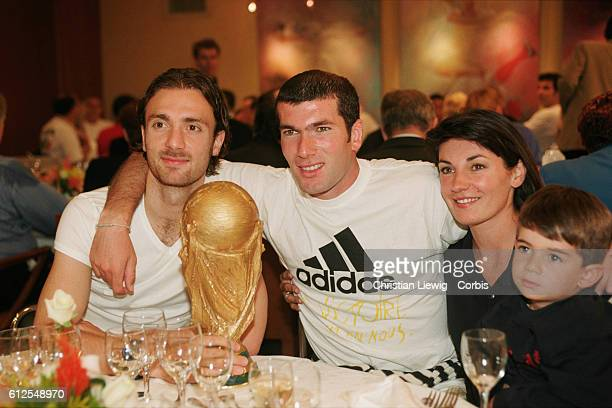 France's players are received at the French soccer federation after their 30 victory over Brazil in the final of the 1998 FIFA World Cup Christophe...