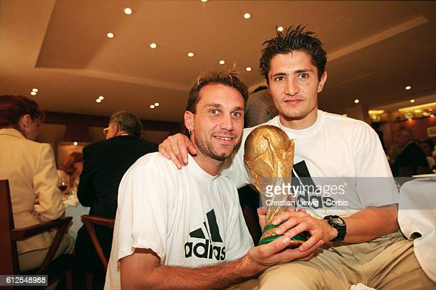 France's players are received at the French soccer federation after their 30 victory over Brazil in the final of the 1998 FIFA World Cup Lionel...