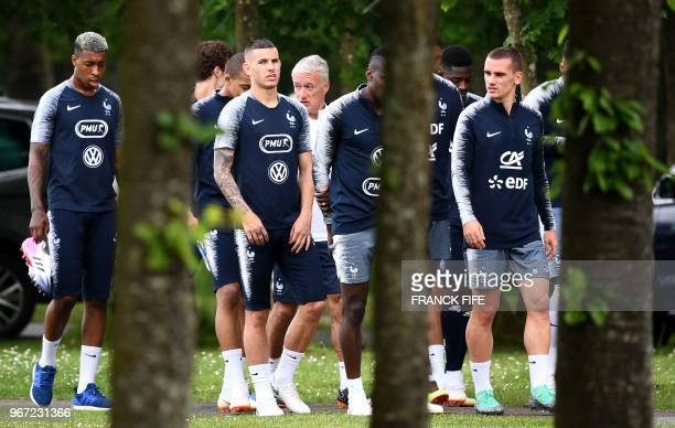 France's players arrive for a training session in ClairefontaineenYvelines on June 4 as part of the team's preparation for the upcoming FIFA World...