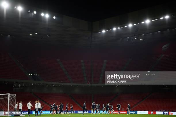 France's players attend a training session at the National Arena in Tirana, on November 16, 2019 on the eve of the Euro 2020 qualifying football...