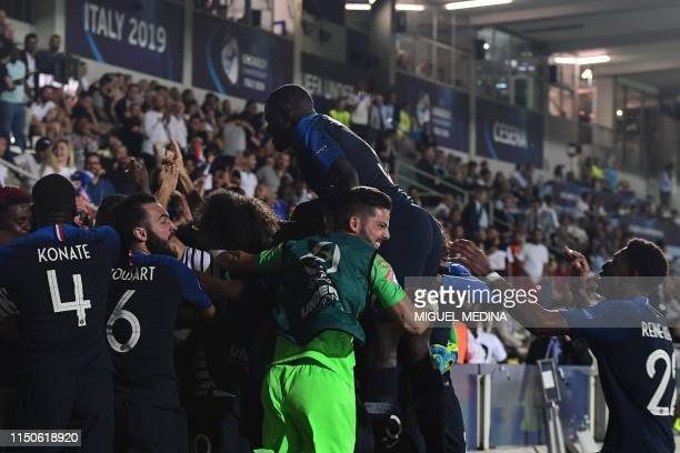 France's players celebrate after England scored an own goal during the Group C match of the U21 European Football Championships between England and...