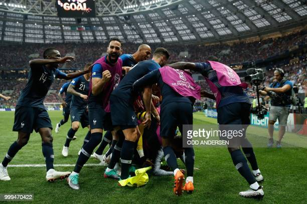 TOPSHOT France's players celebrate after midfielder Paul Pogba scored the 31 goal during the Russia 2018 World Cup final football match between...