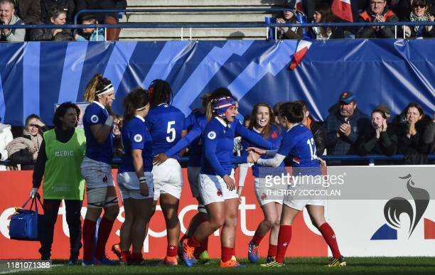 France's players celebrate after scoring a try during the international women's Rugby union test match between France and England at the Marcel...