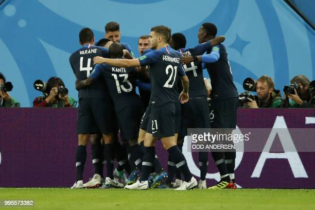 France's players celebrate after scoring the opener during the Russia 2018 World Cup semifinal football match between France and Belgium at the Saint...