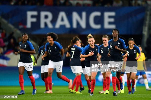 TOPSHOT France's players celebrate after scoring the second goal during a friendly women's football match between France and Brazil at the Allianz...