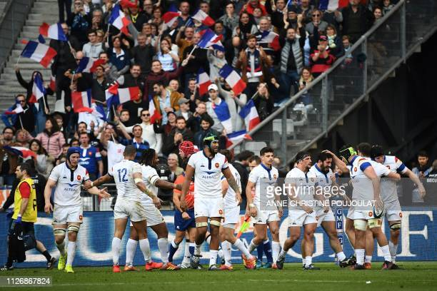 France's players celebrate after their third try during the Six Nations rugby union tournament match between France and Scotland at the Stade de...