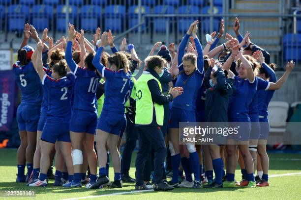 France's players celebrate after their victory at the end of the Six Nations international women's rugby union match between Ireland and France at...