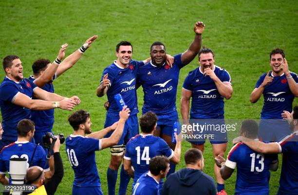 France's players celebrate after winning at the end of the Six Nations rugby union tournament match between France and Ireland at the stade de...