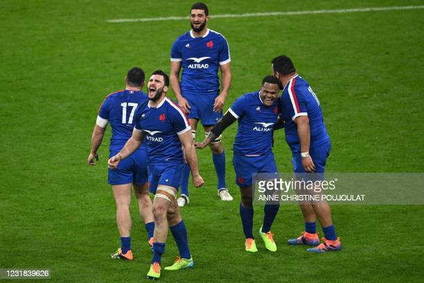 France's players celebrate after winning the end of the Six Nations rugby union tournament match between France and Wales on March 20 at the Stade de...