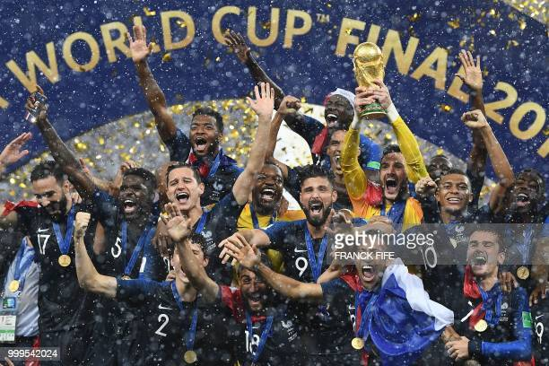 TOPSHOT France's players celebrate as they hold their World Cup trophy during the trophy ceremony at the end of the Russia 2018 World Cup final...