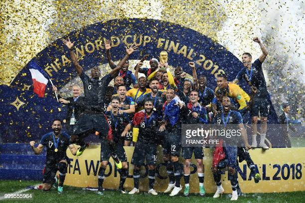 France's players celebrate as they hold their World Cup trophy during the trophy ceremony at the end of the Russia 2018 World Cup final football...