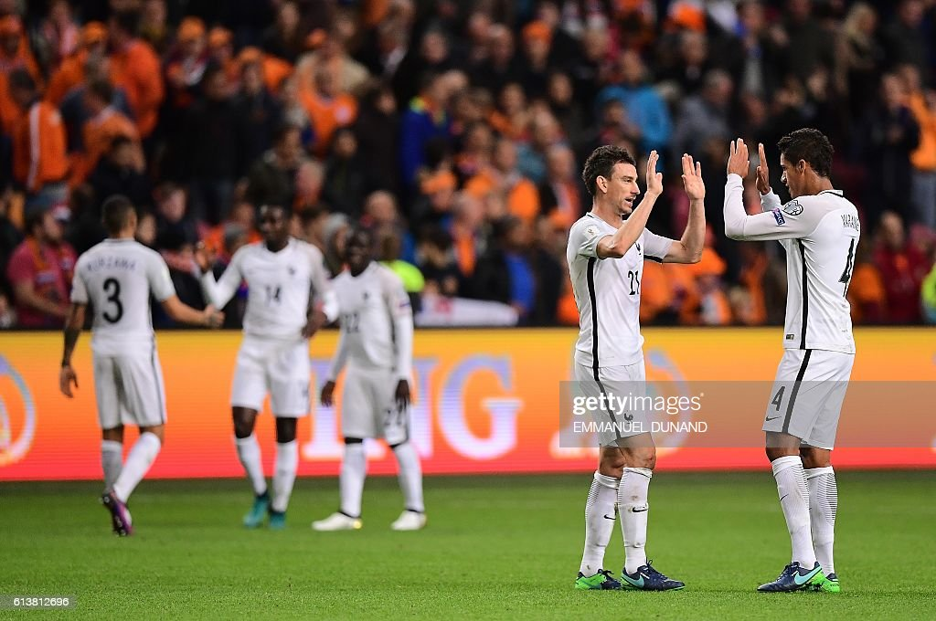 France's players celebrate at the end of the FIFA World Cup 2018 qualifying football match Netherlands vs France on October 10, 2016 at the Amsterdam Arena in Amsterdam. / AFP / EMMANUEL