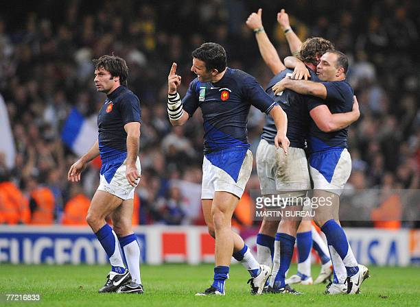 France's players celebrate at the end of the rugby union World Cup quarterfinal match New Zealand vs France 06 October 2007 at the Millennium stadium...