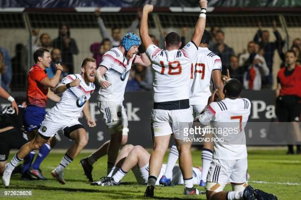 France's players celebrate at the end of the U20 World Rugby union Championship semifinal match between France and NewZealand at the Aime Giral...
