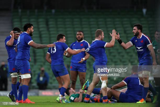 France's players celebrate on the final whistle in the Six Nations international rugby union match between Ireland and France at the Aviva Stadium in...