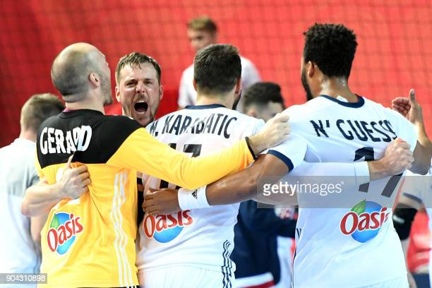 France's players celebrate their victory against Norway during the preliminary round group B match of the Men's 2018 EHF European Handball...
