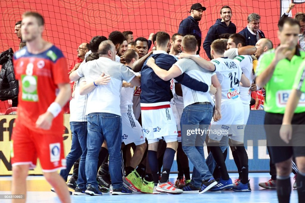 France's players celebrate their victory against Norway during the preliminary round group B match of the Men's 2018 EHF European Handball Championship between France and Norway in Porec, Croatia on January 12, 2018. /