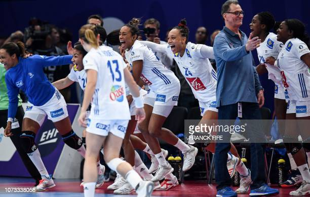 France's players celebrate their victory at the end of the EHF EURO 2018 European Women's Handball Championship semifinal match between Netherlands...