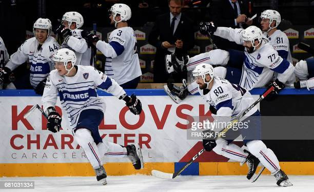 France's players celebrate their victory at the end of the IIHF Men's World Championship group B ice hockey match between Switzerland and France on...