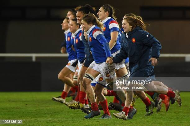 France's players celebrate their victory at the end of the Six Nations women rugby union tournament match between France and Wales at the GGL stadium...