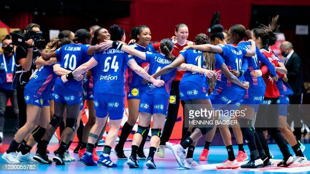 France's players celebrate their victory in the main round match between France and Spain of the 2020 EHF European Women's Handball Championship...