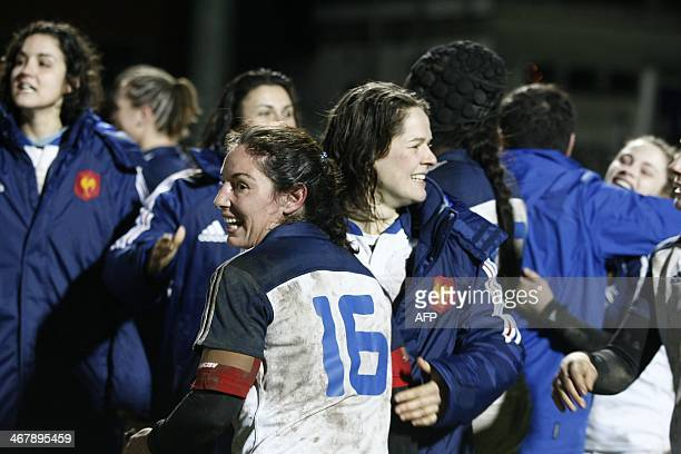France's players celebrate their victory over Italy at the end of the Women's Six Nations rugby union match France vs Italy at the Stade Ernest...