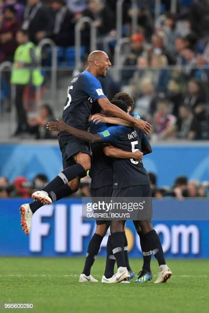 France's players celebrate their win at the end of the Russia 2018 World Cup semifinal football match between France and Belgium at the Saint...